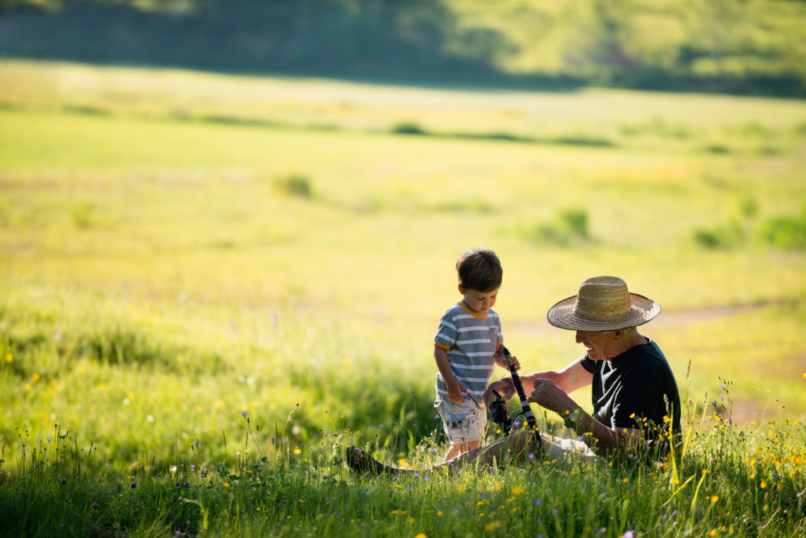 Grandfather and grandson in outdoor activities