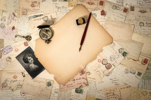 blank piece of antique paper, old accessories and postcards. sentimental vintage background