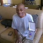 Herman Rivera with Purple Heart